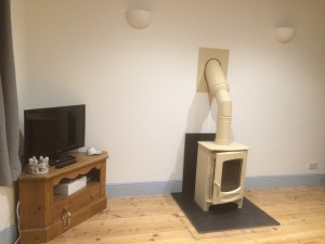 This flue pipe and twin wall flue components were painted with stove paint to match the stove