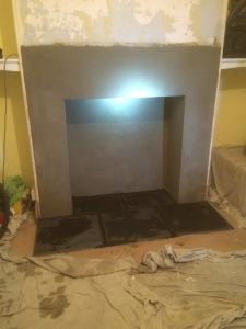The internal fireplace is rendered, the hearth laid. All ready for the stove install and the plastering on the chimney breast